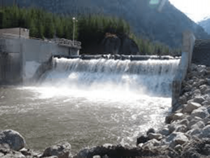 Water spilling over a dam