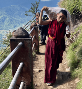 Young monk on path in Bhutan